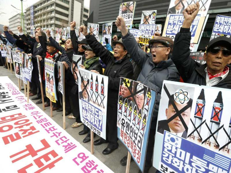 Anti-North Korean protesters from conservative, right-wing and pro-U.S. civic groups, chant slogans during a protest in central Seoul. North Korea celebrated the 101st anniversary of its founder's birth with flowers on Monday, although there was no sign of tension easing as South Korea warned that the North's survival could be in question without change and development. (Reuters)