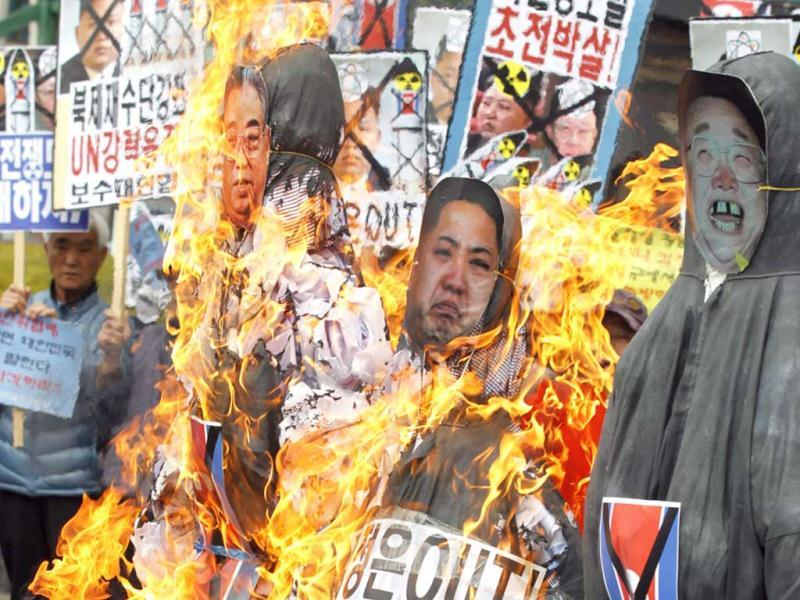 Anti-North Korean protesters from conservative, right-wing and pro-U.S. civic groups, burn effigies of late North Korean leader Kim Jong-il, current leader Kim Jong-un and the North's founder Kim Il-sung during a protest in central Seoul. North Korea celebrated the 101st anniversary of its founder's birth with flowers on Monday, although there was no sign of tension easing as South Korea warned that the North's survival could be in question without change and development. (Reuters)