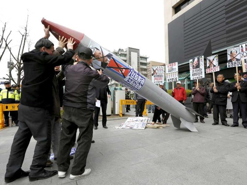 South Korean protesters lift up a mock North Korean missile during an anti-North Korea protest on the birthday of North Korea's late leader Kim Il Sung in Seoul, South Korea. (AP)