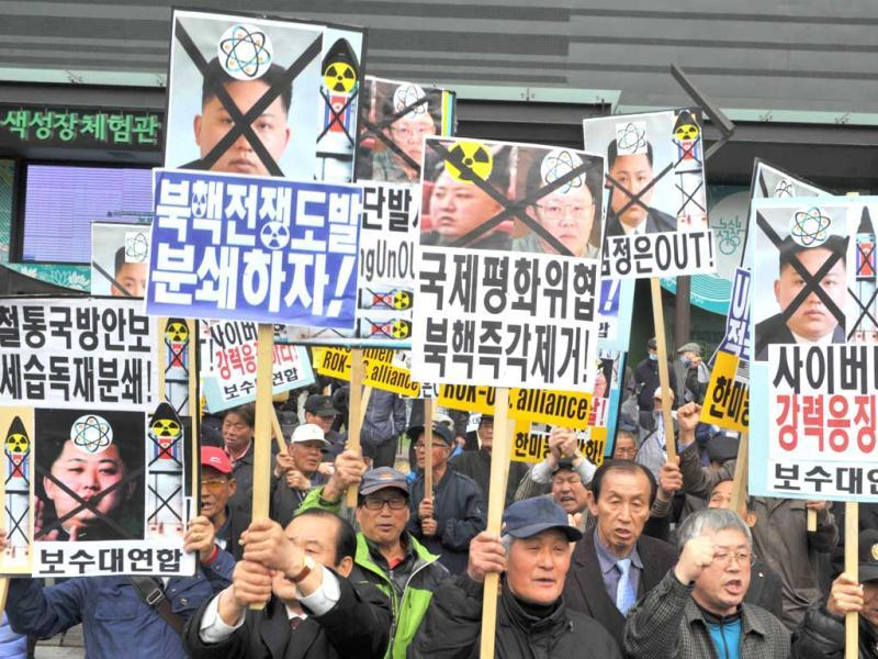 Dozens of South Korean activists hold anti-North Korea placards and chant slogans during an anti-Pyongyang rally in Seoul, marking the 101st birthday of the North's founder and late president Kim Il-Sung amid expectations that Pyongyang could fire missiles. Meanwhile South Korea voiced regret on April 15 at North Korea's dismissal of its offer for dialogue, as the South's armed forces remained on heightened alert for an expected missile test by Pyongyang. (AFP)