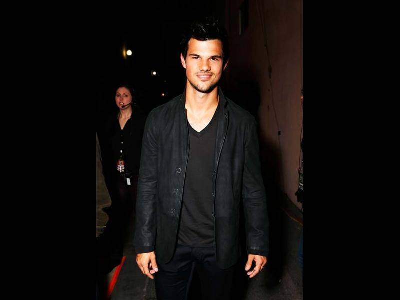 Actor Taylor Lautner poses backstage at the MTV Movie Awards in Sony Pictures Studio Lot in Culver City, California (MTV/AP Images)