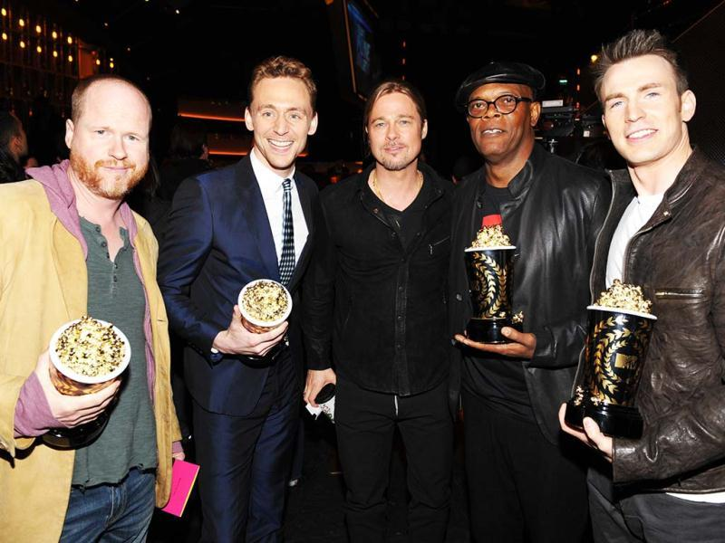 Actor Brad Pitt, center, and from left, director Joss Whedon, actors Tom Hiddleston, Samuel L. Jackson and Chris Evans, from the cast of The Avengers, winner of the award for movie of the year, pose backstage at the MTV Movie Awards in Sony Pictures Studio Lot in Culver City, Calif., on Sunday April 14, 2013. (MTV/AP Images)