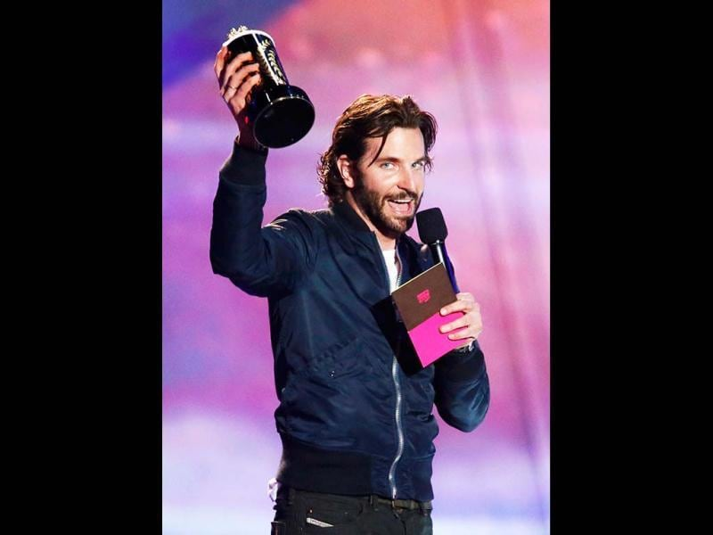 Actor Bradley Cooper accepts the award for Best Kiss he shares with actress Jennifer Lawrence for Silver Linings Playbook at the 2013 MTV Movie Awards in Culver City, California. He also won the Best Male Performance for Silver Linings Playbook. (Reuters Images)