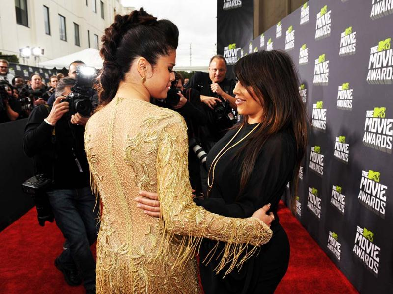 Too much love! Selena Gomez and Kim Kardashian can't stop hugging each other as they arrive at the MTV Movie Awards in Sony Pictures Studio Lot (AP Images)PS: That's quite some height difference!