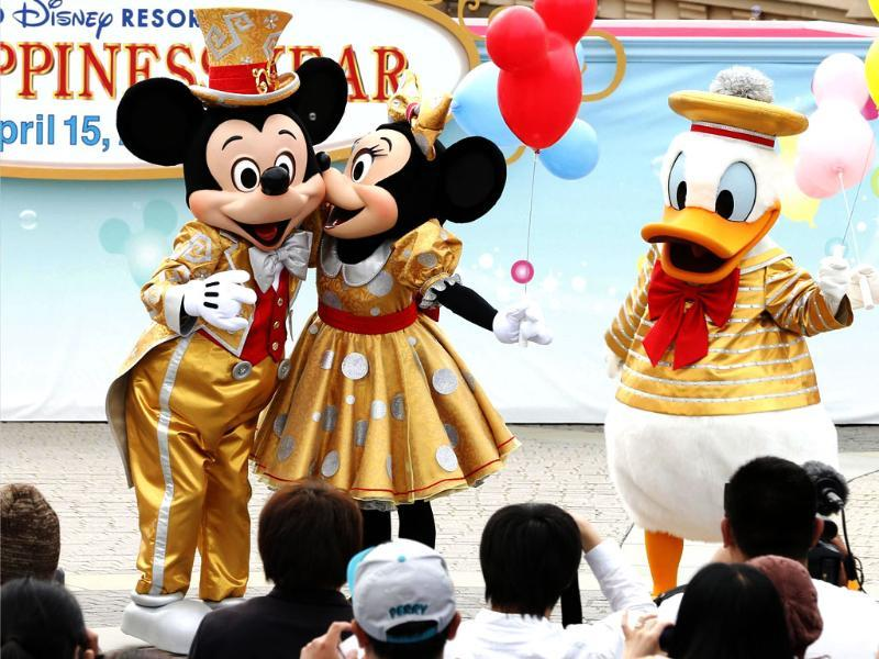 Mickey Mouse, Minnie Mouse and Donald Duck entertain visitors in front of Cinderella Castle during a special performance to celebrate the 30th anniversary of the opening of Tokyo Disneyland in Urayasu, Tokyo. AP Photo