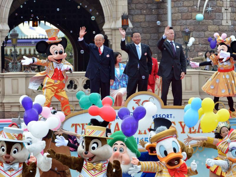 Tokyo Disneyland operator Oriental Land chairman Toshio Kagami, president Kyoichiro Uenishi and Walt Disney parks and resort chairman Tom Staggs, accompanied by Mickey and Minnie Mouse, celebrate the 30th anniversary of the Tokyo Disneyland during a ceremony at the Disney theme park in Tokyo. AFP