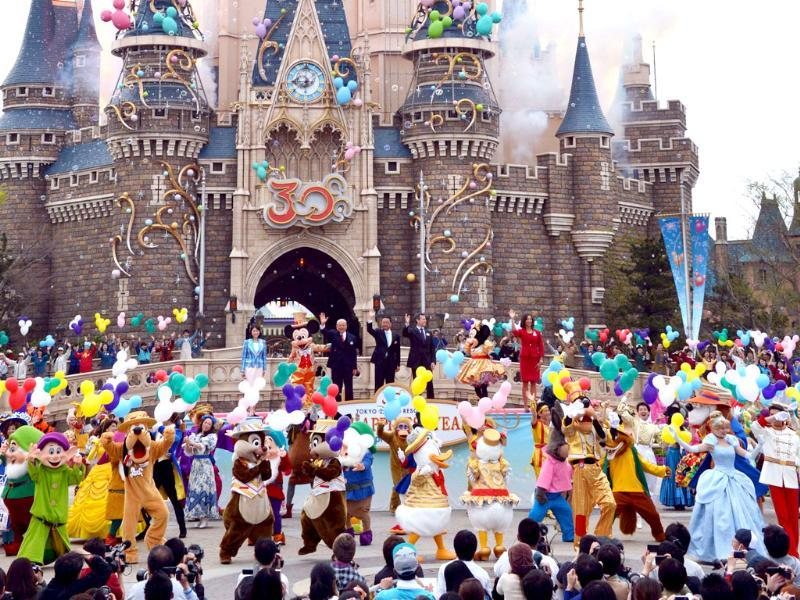 Disney characters and dancers celebrate the 30th anniversary of the Tokyo Disneyland during a ceremony at the Disney theme park in Tokyo. AFP