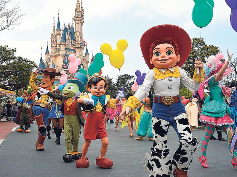 Disney characters and dancers parade as the Tokyo Disneyland celebrates its 30th anniversary in Tokyo. AFP