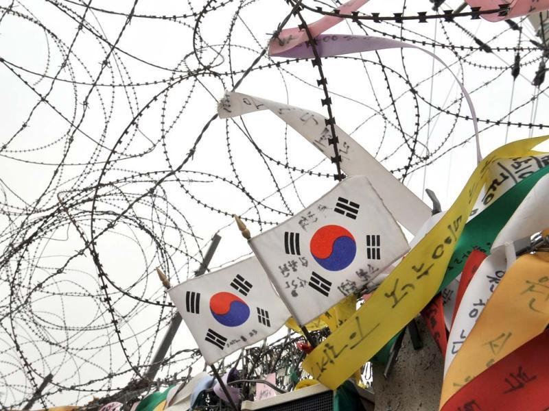 South Korean flags hanging on a military barbed wire fence flutter in the wind at Imjingak peace park near the Demilitarized Zone (DMZ) dividing the two Koreas in the border city of Paju. (AFP)