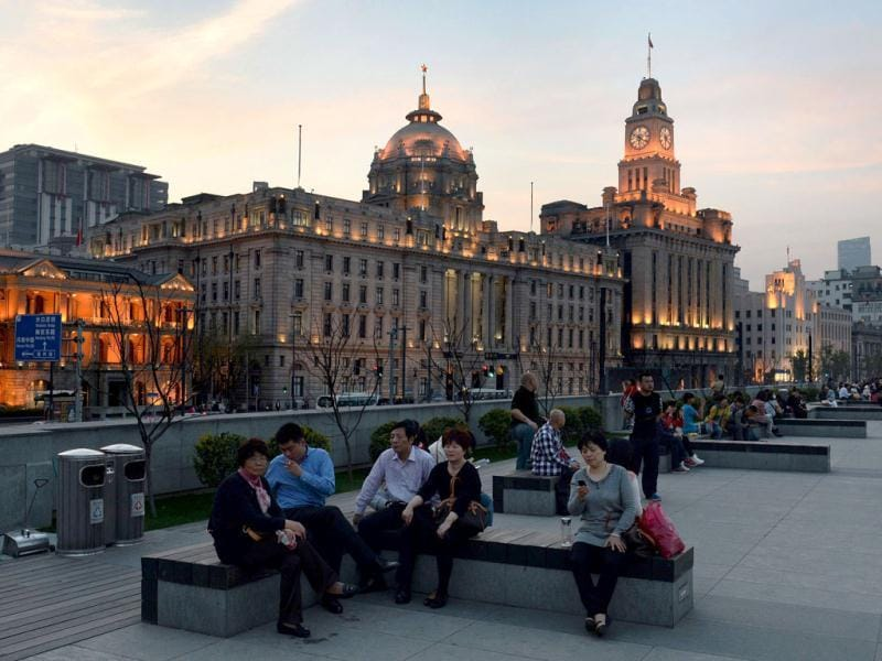 Tourists are seen in front of the old Hong Kong Bank building on the historic Bund of Shanghai. (AFP)