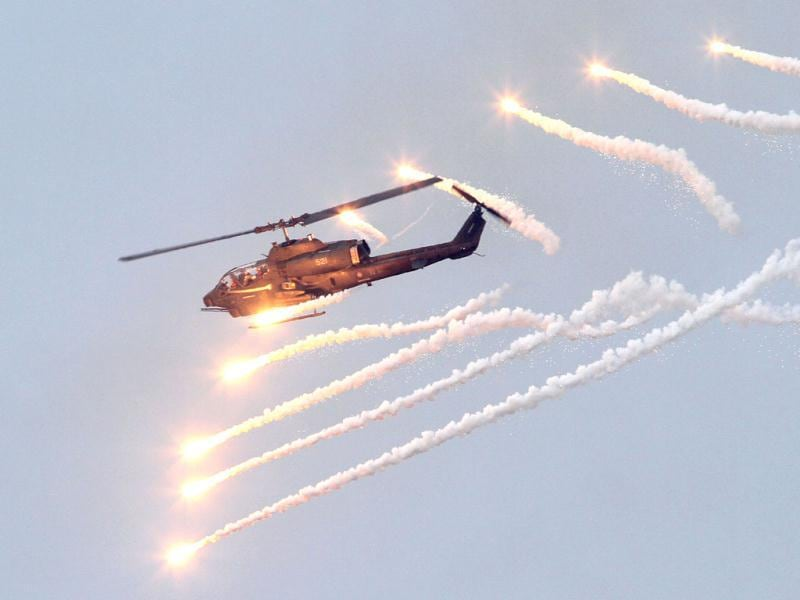 An AH-1W Attack Helicopter launches flares during Han Kuang military exercises in Penghu county, Taiwan. (AP)