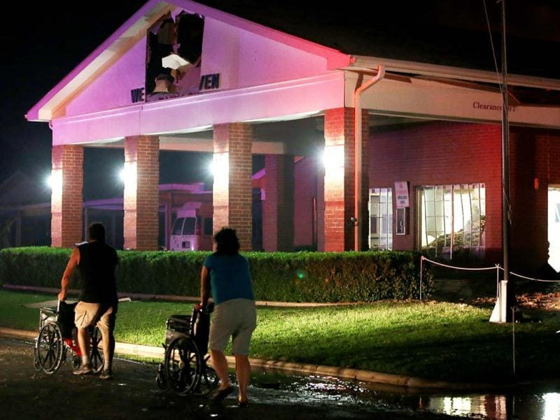People seen pushing wheel chairs in front of a damaged nursing home following an explosion at a nearby fertilizer plant in West, Texas. AP photo