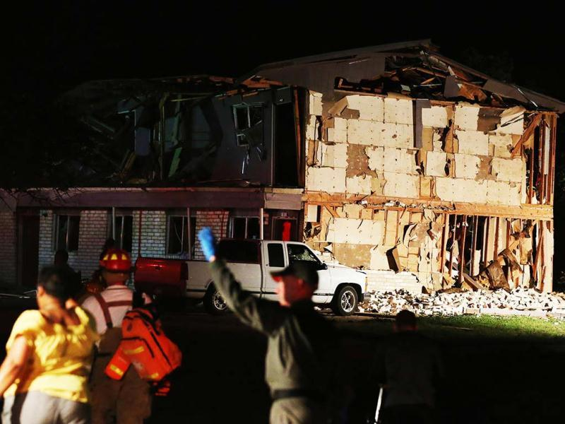 Rescue workers work near a damaged apartment complex after a nearby fertilizer plant exploded in West, Texas. AP photo