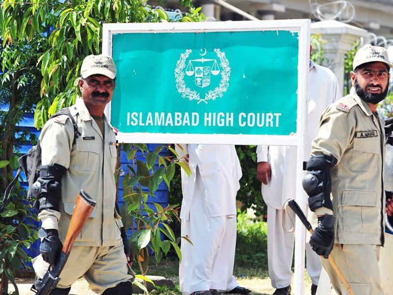 Pakistani paramilitary soldiers exit the high court after the case hearing of former military ruler Pervez Musharraf in Islamabad. (AFP)