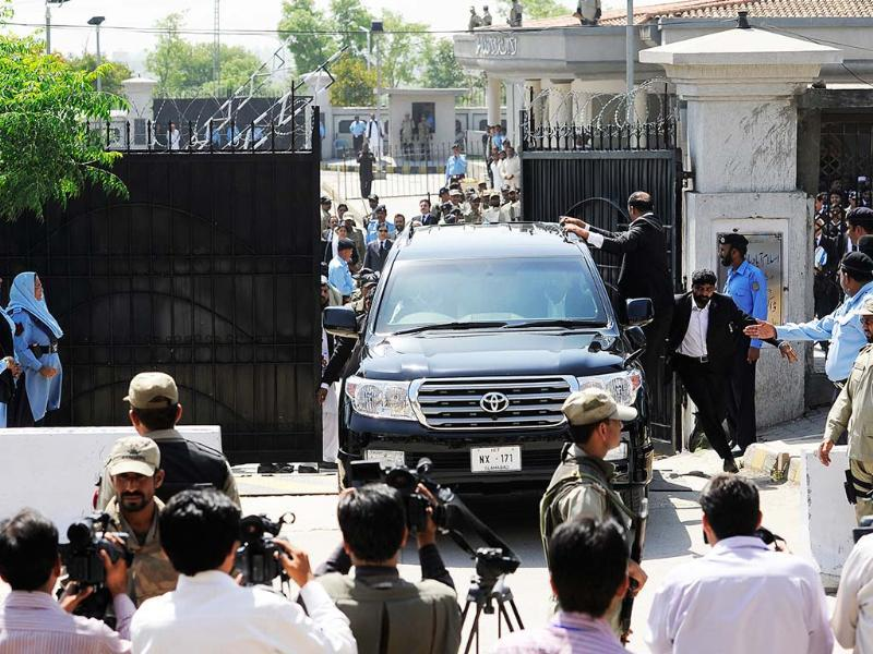 Pakistan's former President and military ruler Pervez Musharraf leaves the high court in Islamabad, Pakistan. Musharraf and his security team pushed past policemen and sped away from a court in the country's capital after his bail was revoked. AP