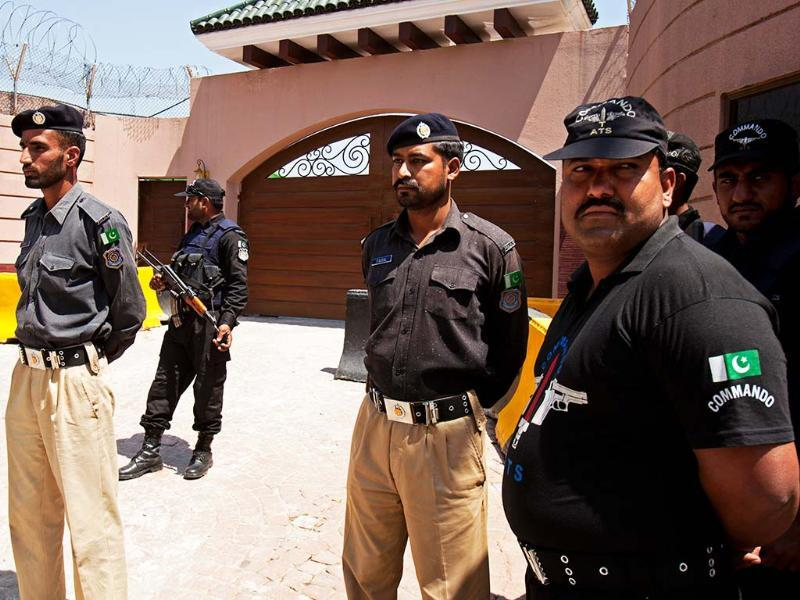 Pakistan police officers stand alert outside the house of Pakistan's former President and military ruler Pervez Musharraf in Islamabad, Pakistan. AP