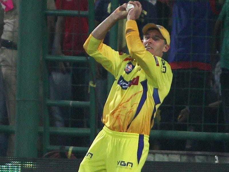Chennai Super Kings' M Hussey catches Delhi Daredevils Virender Sehwag's shot during their match in New Delhi. (PTI Photo)