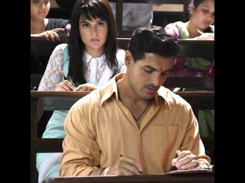 Contrary to his projected role of a gangster in the film, John Abraham looks rather innocent in this still along with Kangana Ranaut.