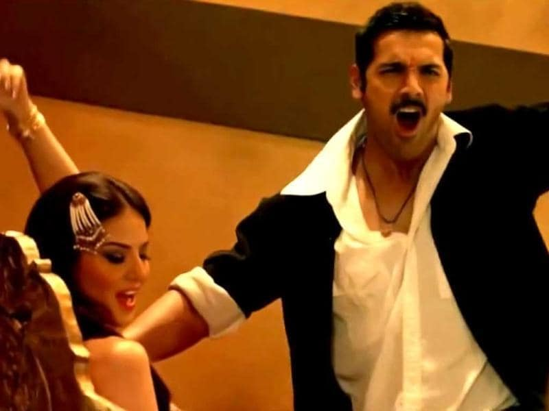 John Abraham's character frolicking with item girl Sunny Leone in the song Laila from Shootout At Wadala.