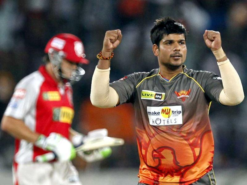 Sunrisers Hyderabad player Karan Sharm celebrates the wicket of Kings XI Punjab captain Adam Gilchrist during T20 cricket match between Sunrisers Hyderabad (SRH) and Kings XI Punjab (KXIP) at Rajiv Gandhi International Stadium, in Hyderabad. HT Photo/Kunal Patil