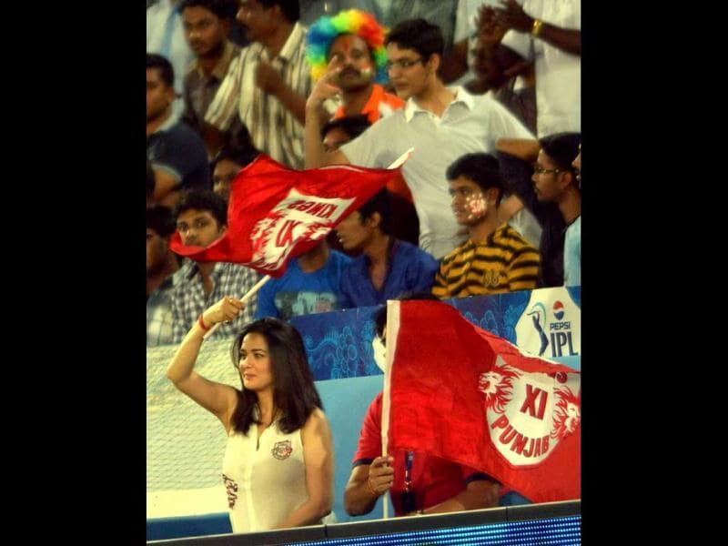 Kings XI Punjab's owner and actor Preity Zinta cheers her team during an T20 match against Sunrisers Hyderabad at Uppal near Hyderabad. PTI