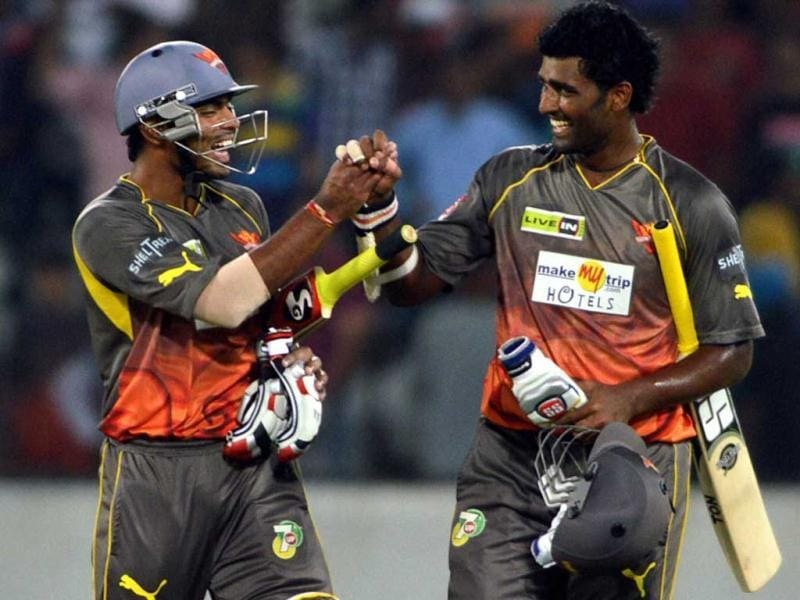 Sunrisers Hyderabad batsmen Ashish Reddy and Thisara Perera celebrate their victory over Kings XI Punjab during the T20 match at Uppal near Hyderabad. PTI