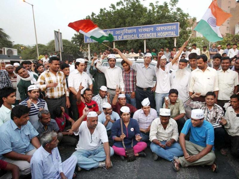 Aam Admi Party volunteers protesting against the brutal rape of a five-year-old girl outside the AIIMS hospital in New Delhi. (PTI Photo)