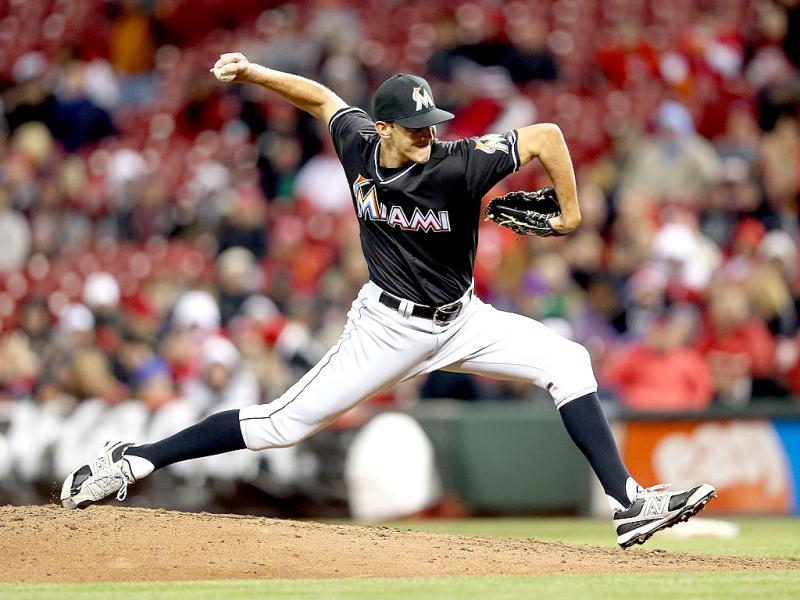 Steve Cishek #31 of the Miami Marlins throws a pitch during the game against the Cincinnati Reds at Great American Ball Park in Cincinnati, Ohio. (AFP)