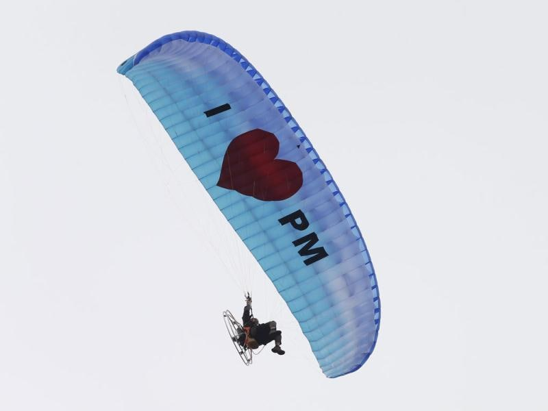 A paraglider sails past showing support for Malaysia's Prime Minister Najib Razak, as Najib arrives to submit his nomination papers to contest in Pekan constituency for the upcoming general elections in Pekan. (Reuters)