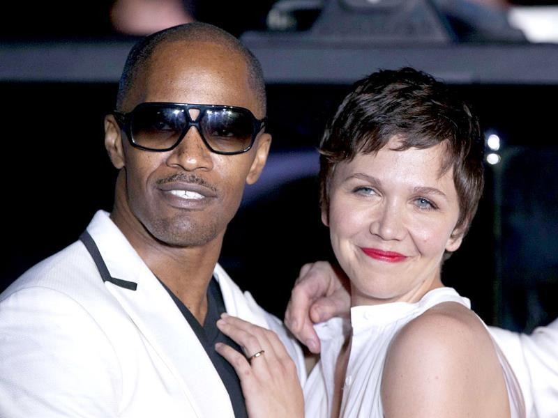 US actors Jamie Foxx and Maggie Gyllenhaal pose for photos to promote their upcoming film