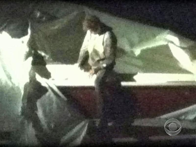 An image obtained courtesy CBS News shows Dzhokhar Tsarnaev, a suspect in the Boston Marathon bombing who was captured after he was found hiding in a boat in a Boston suburb. (AFP)