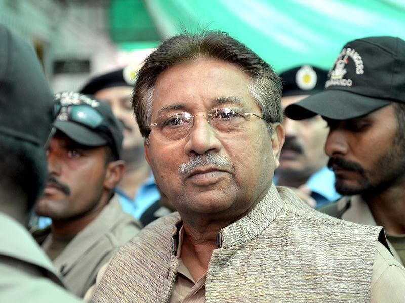 Former Pakistani president Pervez Musharraf is escorted by soldiers as he arrives at an anti-terrorism court in Islamabad. AFP photo