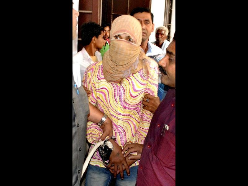 Delhi Police personnel take away Manoj Kumar, accused of brutally raping a five-year-old girl in the capital, in Muzaffarpur in Bihar. PTI Photo