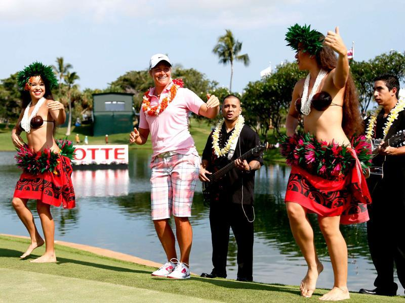 Suzann Petersen of Norway dances with hula dancers after winning the LPGA LOTTE Championship Presented by J Golf at the Ko Olina Golf Club in Kapolei, Hawaii. AFP