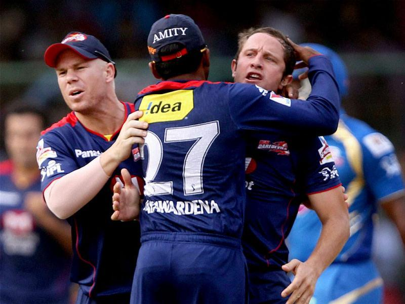 Delhi Daredevils cricketers celebrate the dismissal of Mumbai Indians batsman Dwayne Smith during the T20 League match in New Delhi. PTI