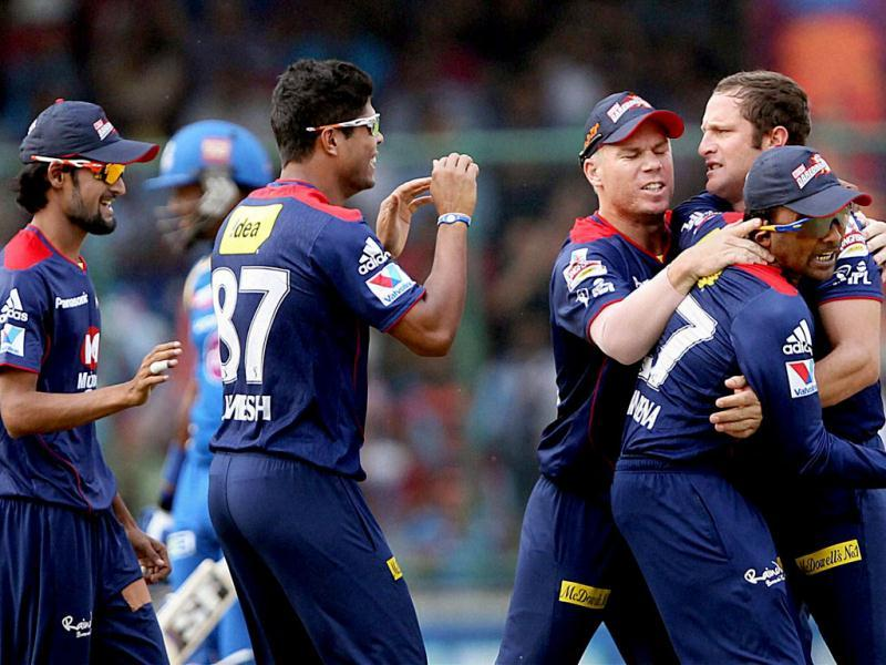 Delhi Daredevils players celebrate the dismissal of Mumbai Indians batsman Dwayne Smith during the T20 League match at Firozshah Kotla in New Delhi. PTI