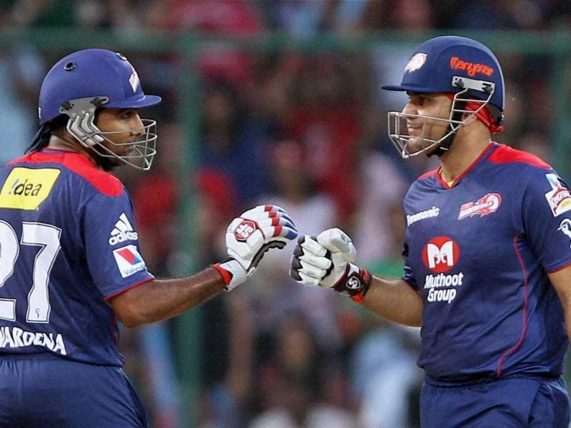 Delhi Daredevils players Virender Sehwag and Mahela Jayawardene celebrate their partnership during the T20 League match against Mumbai Indians at Firozshah Kotla stadium in New Delhi. PTI