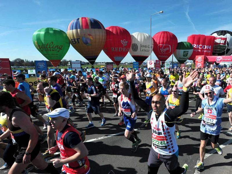 Runners take part in the 2013 London Marathon in southeast London. AFP Photo