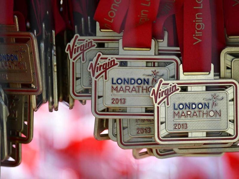 Finishers' medals are seen hanging after the finish line of the London Marathon. Undaunted by the Boston Marathon bombings, big crowds lined the route of London's mass road race on Sunday to cheer on around 36,000 runners, many of whom wore black ribbons to remember the dead and wounded. Reuters
