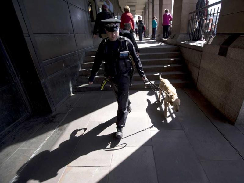 Max, a member of a British police explosive dog search team patrols with his handler outside Westminster station beside the route of the London Marathon. The London Marathon started in defiant mood on a glorious sunny morning Sunday despite concerns raised by the bomb attacks on the Boston Marathon six days ago. London's is the first major international marathon since the double bomb attack near the finish line in Boston, which left three people dead and more than 170 injured, including many who are still hospitalized. AP Photo