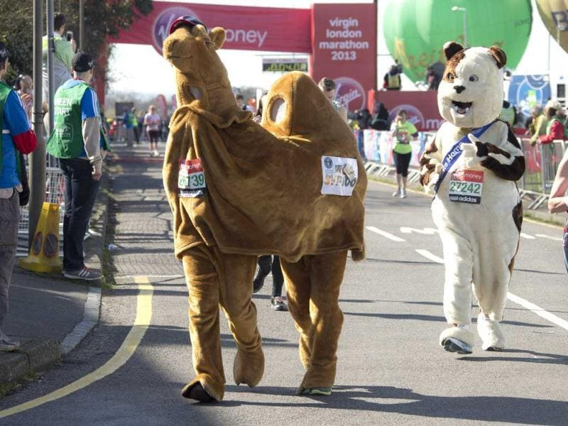 Fun runners dressed as a camel and a dog, set off at the start of this year's Virgin London Marathon, at the Green Start Line, in Greenwich Park, east London. AP Photo