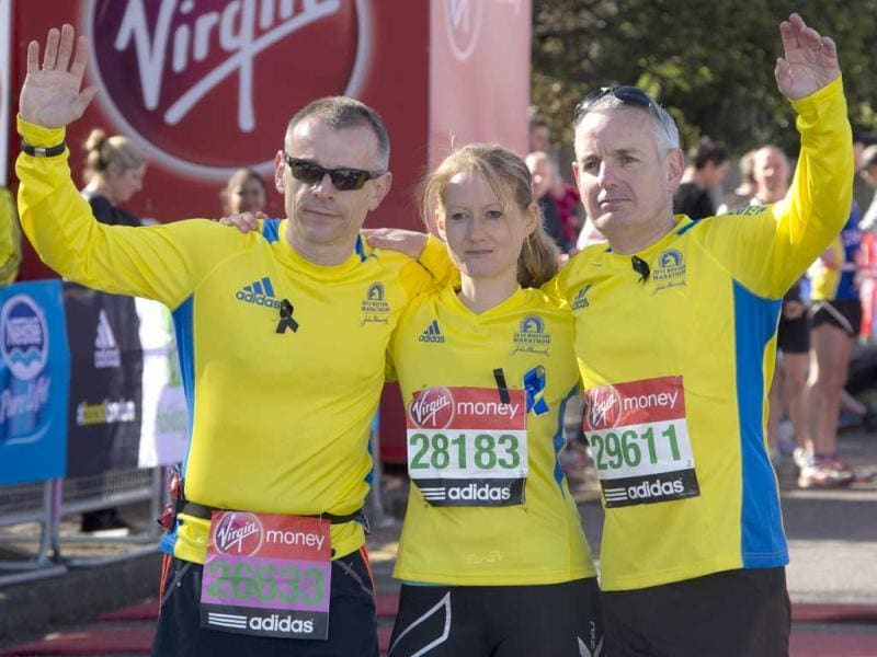 Craig Smith, left, Trisha Bunn and Keith Luxon, Brits who ran in the Boston marathon, shows their support in this year's Virgin London Marathon, at the Green Start Line, in Greenwich Park, east London. AP Photo