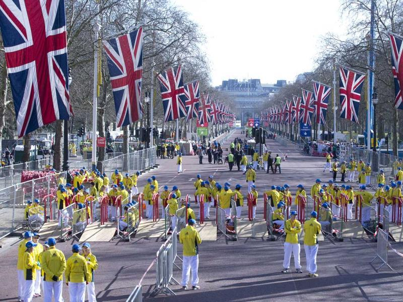 Volunteers in bright yellow get ready prior to the London Marathon in the Mall in London, Sunday, April 21, 2013. Security has been stepped up in London following the recent bombs at the Boston Marathon. The London Marathon started as planned on a glorious sunny morning Sunday despite concerns raised by the bomb attacks on the Boston Marathon six days ago. AP Photo