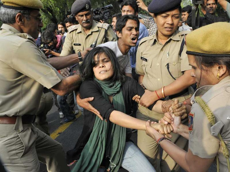 Security personnel try to remove protestors of AAM Party shouting slogans outside Prime Minister's residence during a protest against the rape of a five-year-old girl in New Delhi. HT/Vipin Kumar