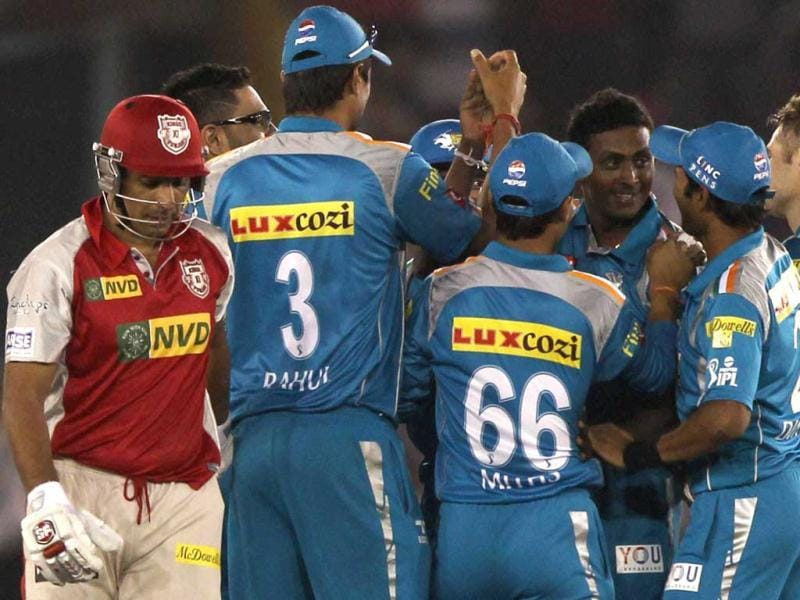 Pune Warriors players celebrate the wicket of Kings XI Punjab Azhar Mahmood during the T20 League match at PCA Stadium in Mohali. PTI