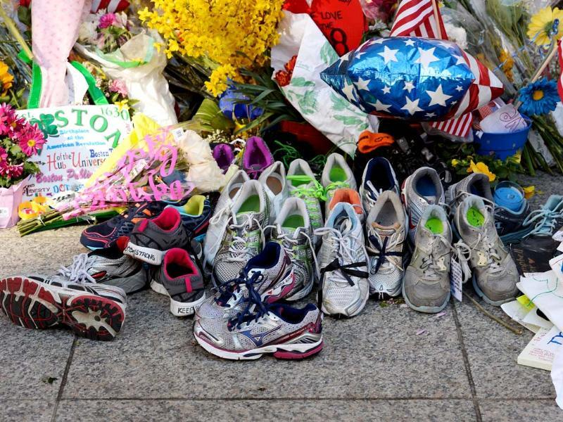 Running shoes are placed at a makeshift memorial for victims near the finish line of the Boston Marathon bombings at the intersection of Boylston Street and Berkley Street two days after the second suspect in the bombings was captured in Boston, Massachusetts. (AFP)