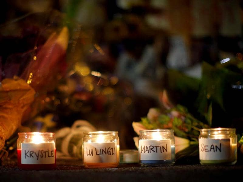 Candles are lit for those who died in the Boston Marathon bombings and the subsequent police manhunt at a memorial on Boylston Street in Boston, Massachusetts. (Reuters)