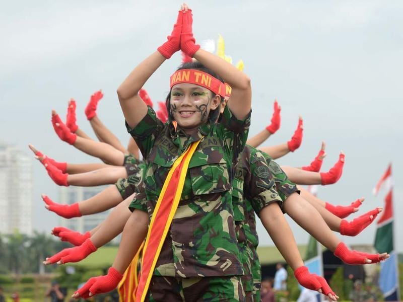 Female members of the Indonesian armed forces perform as they mark Kartini Day in Jakarta. The event is held to enhance integrity and solidarity for Indonesian women commemorating the birth of Raden Ajeng Kartini, an Indonesian heroine born in 1879, a pioneer in the emancipation of Indonesian women. (AFP)