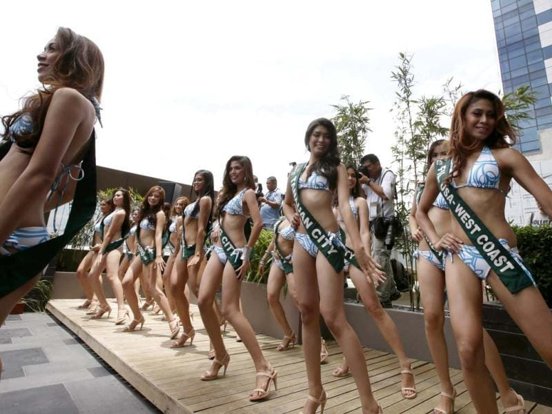 Filipino candidates for this year's Miss Philippines Earth beauty pageant perform a dance number at the poolside of a hotel at suburban Taguig city, east of Manila, Philippines. AP