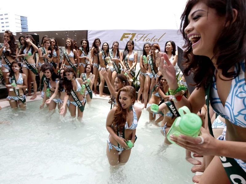 Filipino candidates for this year's Miss Philippines Earth beauty pageant play in the swimming pool of a hotel at suburban Taguig city, east of Manila, Philippines during their presentation. AP